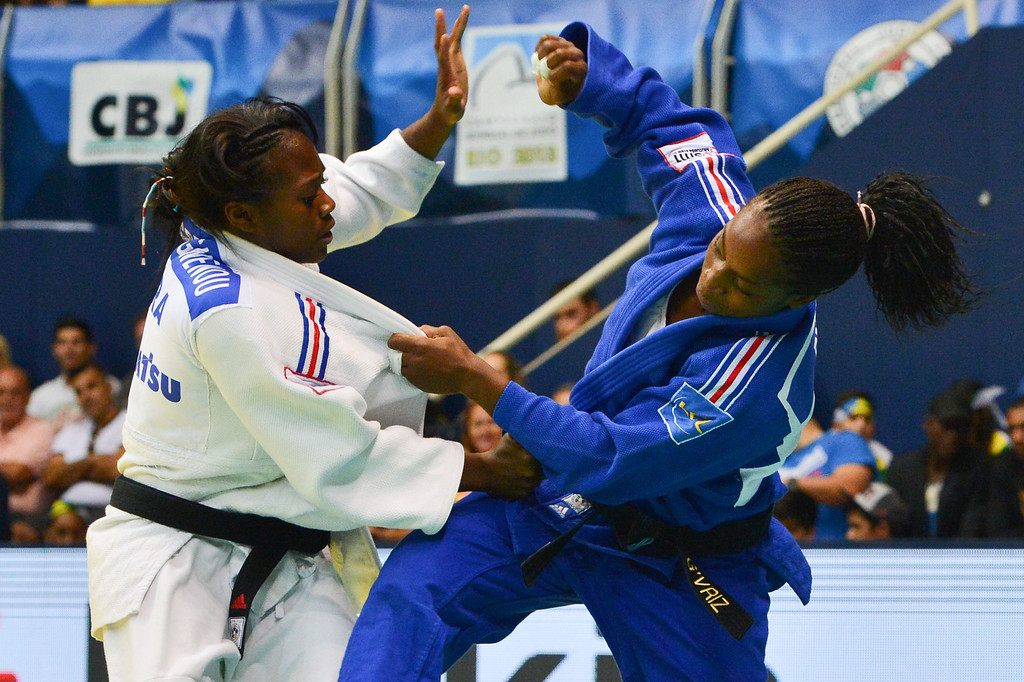 . France\'s Clarisse Agbegnenou (white) competes with France\'s Gevrise Emane in the women\'s -63kg category semifinal, during the IJF World Judo Championship in Rio de Janeiro, Brazil, on August 29, 2013. YASUYOSHI CHIBA/AFP/Getty Images