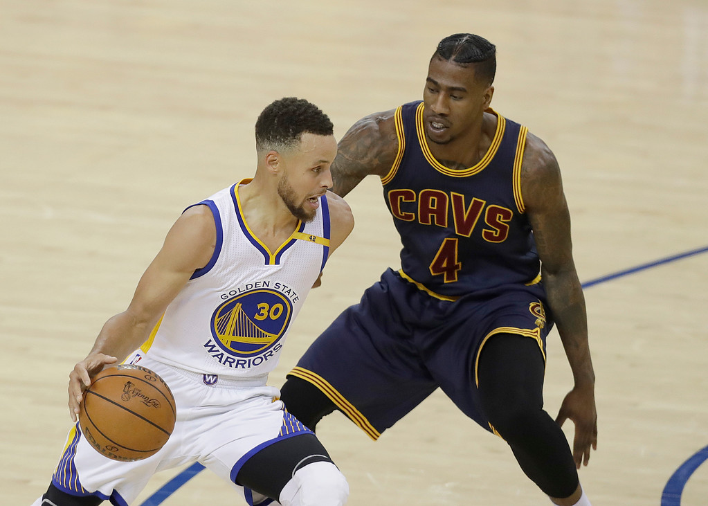 . Golden State Warriors guard Stephen Curry (30) drives on Cleveland Cavaliers guard Iman Shumpert (4) during the first half of Game 1 of basketball\'s NBA Finals in Oakland, Calif., Thursday, June 1, 2017. (AP Photo/Marcio Jose Sanchez)