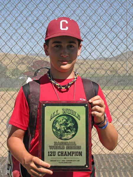 Zack holds championship plaque