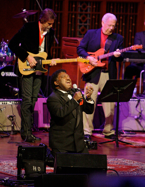 """. FILE - In this Oct. 28, 2008 file photo, Percy Sledge kneels as he performs \""""When a Man Loves a Woman\"""" along with the Muscle Shoals Rhythm Section at the Musicians Hall of Fame awards show in Nashville, Tenn. Sledge, who recorded the classic 1966 soul ballad \""""When a Man Loves a Woman,\"""" died, Tuesday April 14, 2015. He was 73. (AP Photo/Mark Humphrey, File)"""