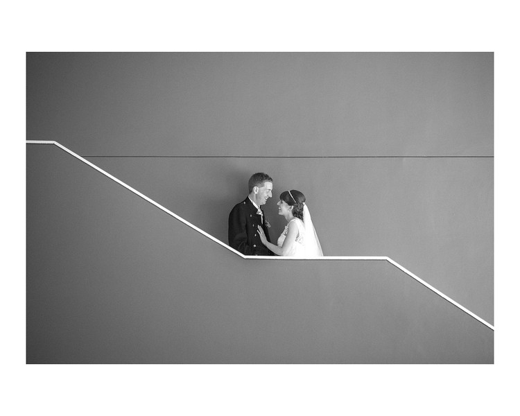 Wedding Photography of Laura & Paul, Apex International, Edinburgh, Scotland, Photograph is of the Bride & Groom standing ion the stairs of the hotel