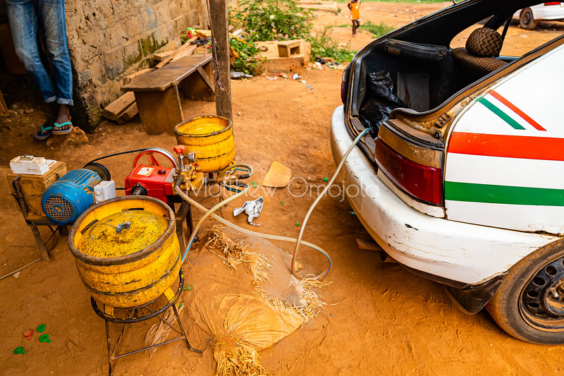 Getting gas! Literally, technology for filling gas into gas powered taxi in Yamoussoukro Ivory Coast Cote d'Ivoire.