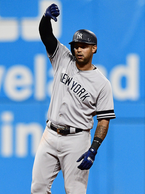. New York Yankees\' Aaron Hicks celebrates after hitting a single and advancing to second base on an error by Cleveland Indians\' Austin Jackson in the ninth inning of Game 5 of baseball\'s American League Division Series, Wednesday, Oct. 11, 2017, in Cleveland. (AP Photo/David Dermer)