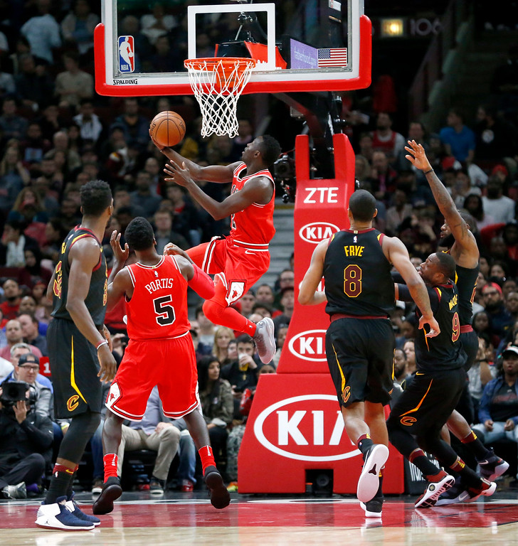 . Chicago Bulls\' Jerian Grant, center, scores on a reverse layup during the first half of an NBA basketball game against the Cleveland Cavaliers Monday, Dec. 4, 2017, in Chicago. (AP Photo/Charles Rex Arbogast)