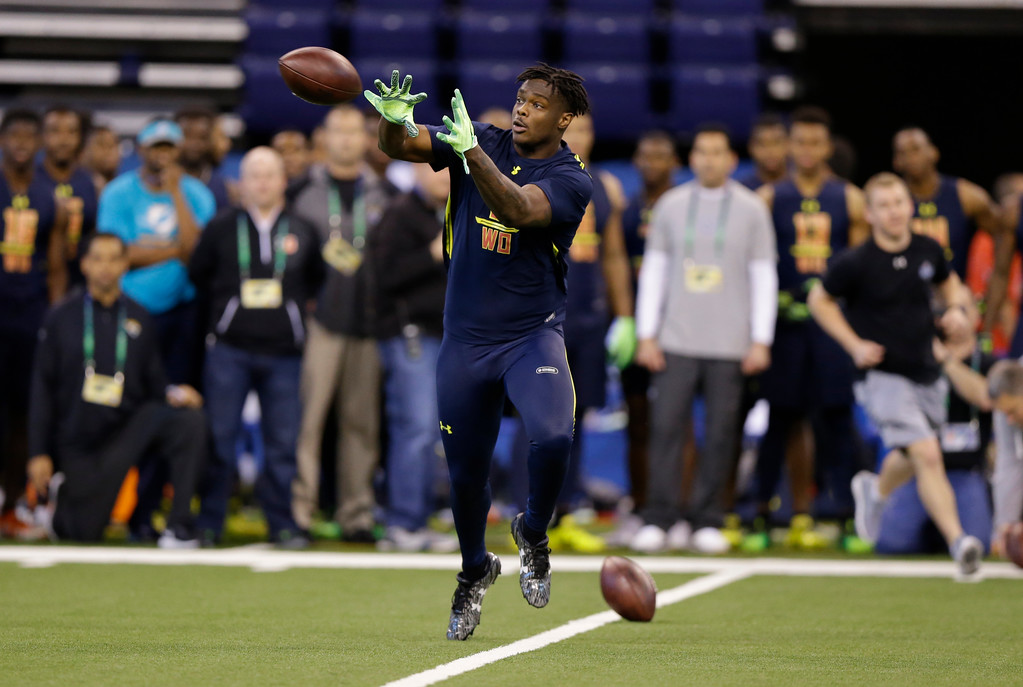 . Ohio State wide receiver Noah Brown runs a drill at the NFL football scouting combine in Indianapolis, Saturday, March 4, 2017. (AP Photo/Michael Conroy)