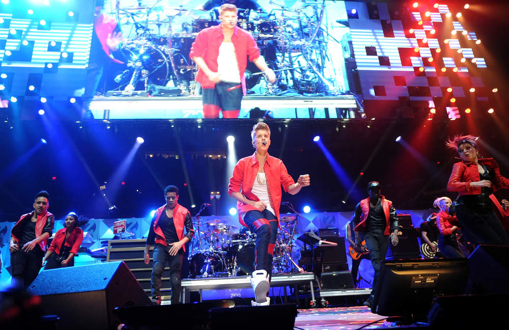 . Singer Justin Bieber performs at Z100\'s Jingle Ball 2012 presented by Aeropostale at Madison Square Garden on Friday Dec. 7, 2012 in New York. (Photo by Evan Agostini/Invision/AP)