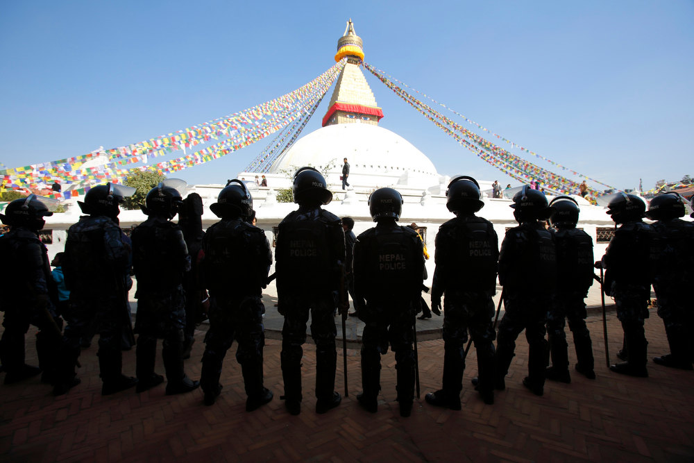 . Nepalese police stand guard at the premises of the Boudhanath Stupa after a Tibetan monk self-immolated in Kathmandu February 13, 2013. REUTERS/Navesh Chitrakar