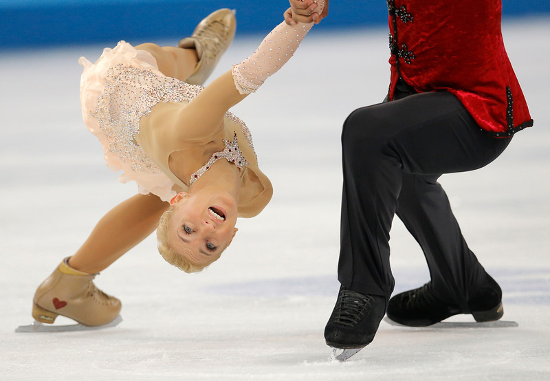 . Aliona Savchenko and Robin Szolkowy of Germany compete in the pairs free skate figure skating competition at the Iceberg Skating Palace during the 2014 Winter Olympics, Wednesday, Feb. 12, 2014, in Sochi, Russia. (AP Photo/Vadim Ghirda)