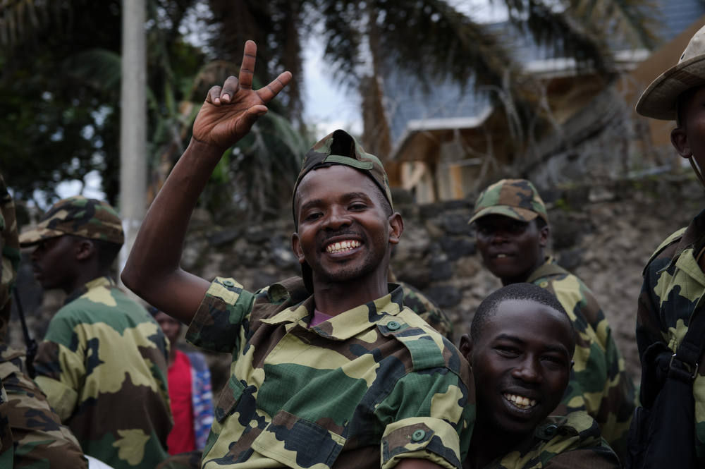 Description of . M23 rebels celebrate in the streets of Goma in the east of the Democratic Republic of the Congo on November 20, 2012. Rebels in the DRC claimed control of the main town of Goma and its airport, in the mineral-rich east, as President Joseph Kabila urged people to defend the country's sovereignty. AFP PHOTO/PHIL MOORE/AFP/Getty Images