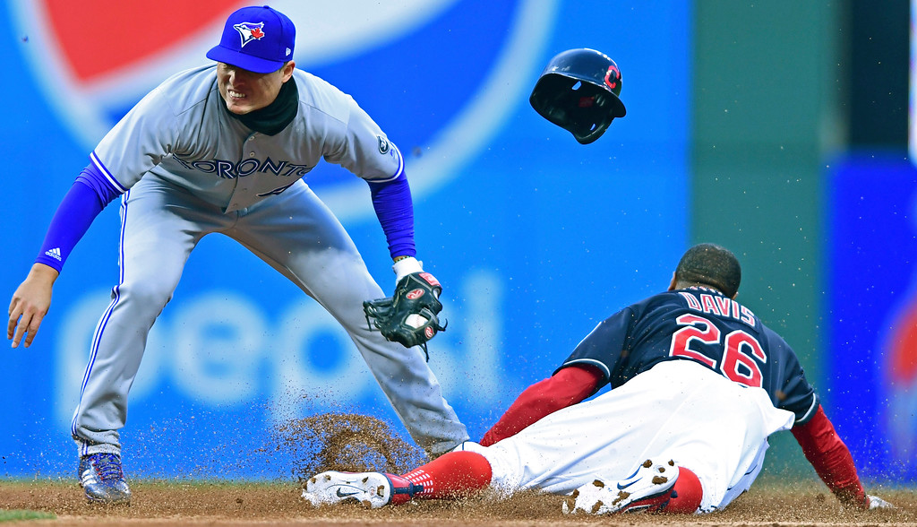 . Toronto Blue Jays\' Aledmys Diaz is late on a tag as Cleveland Indians\' Rajai Davis steals second during the second inning of a baseball game Friday, April 13, 2018, in Cleveland. (AP Photo/David Dermer)