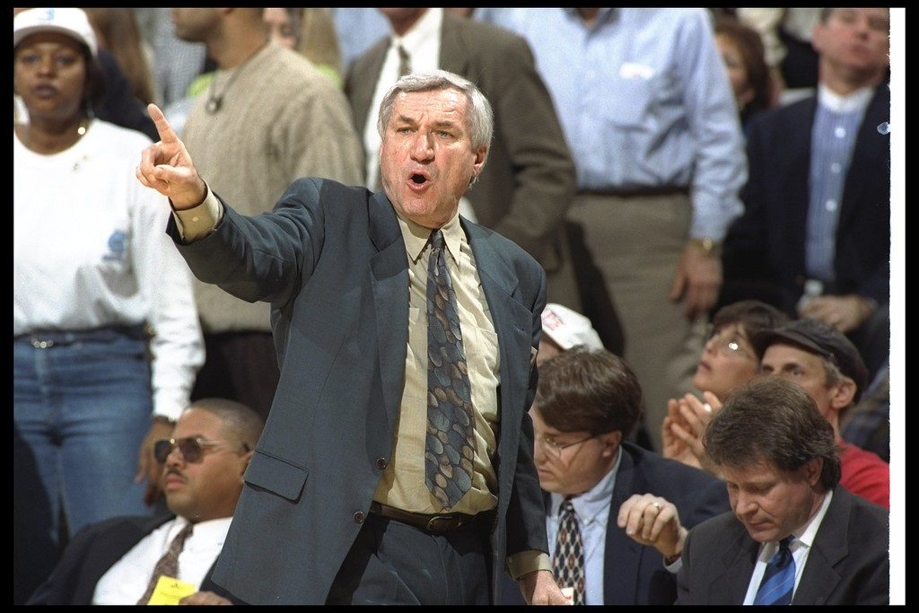 . FILE - FEBRUARY 8:  According to reports February 8, 2015, former North Carolina Tar Heels basketball coach Dean Smith has died at the age of 83. 8 Mar 1997: Coach Dean Smith of the North Carolina Tarheels gives instructions to his players during a playoff game against the Wake Forest Demon Deacons at the Greensboro Coliseum in Greensboro, North Carolina. The Tarheels won the game 86 - 73.