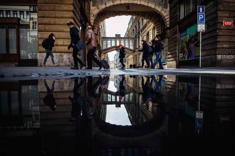 prague puddle crowd crossing morning.jpg