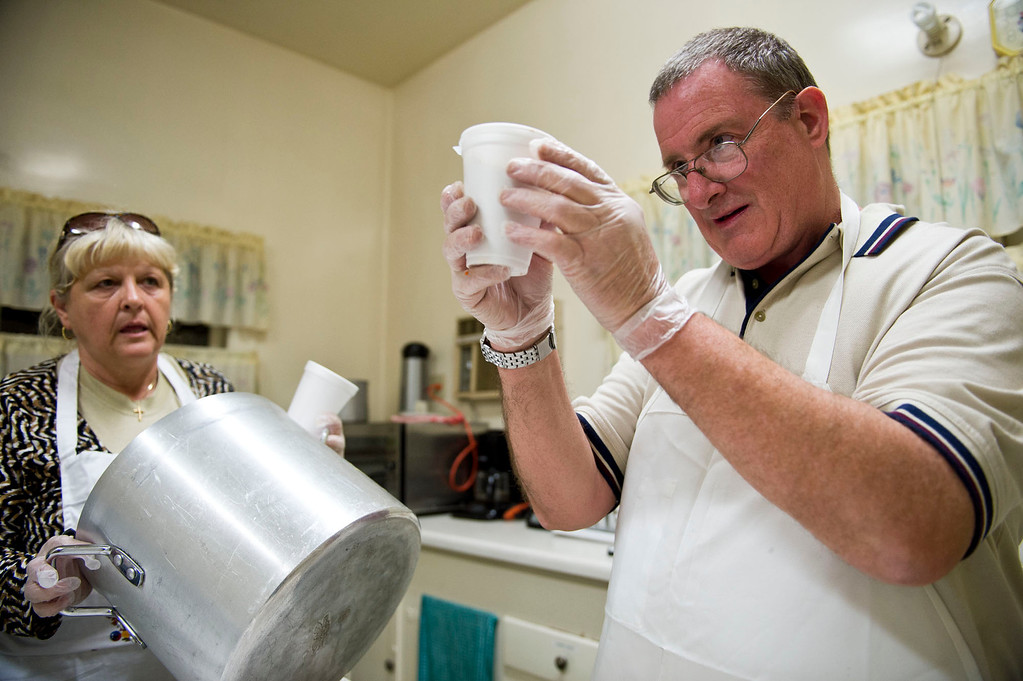 . Phillip Stern and Nicolette Wingert get hot soups ready before distributing the meals at the Church of the Brethren kitchen in Glendora on Wednesday night, Nov. 27, 2013. Nicolette Wingert has been feeding the homeless six days a week for the past seven years with Nurses4Christ, a nonprofit organization she founded in 2006. (Photo by Watchara Phomicinda/San Gabriel Valley Tribune)