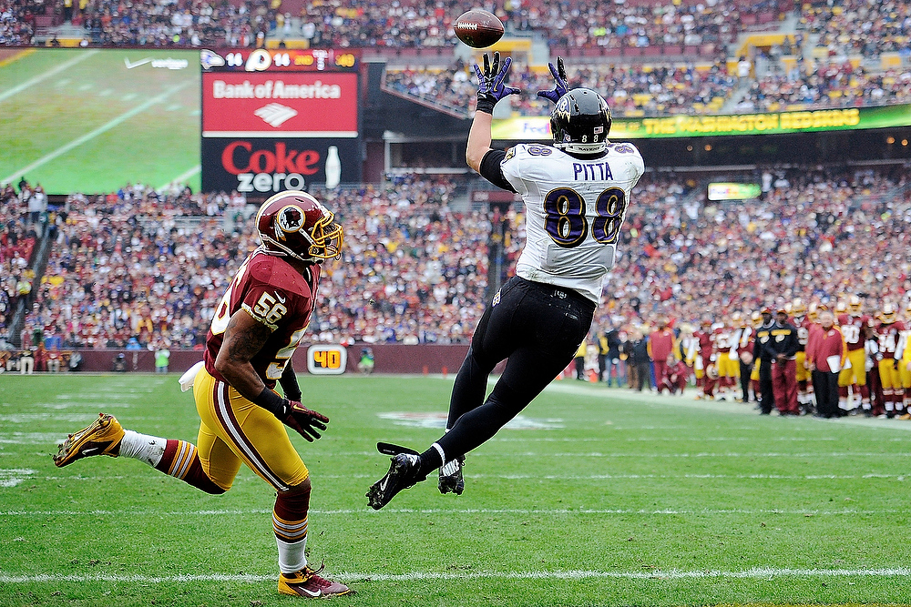 Description of . Washington Redskins inside linebacker Perry Riley (56) watches as Baltimore Ravens tight end Dennis Pitta (88) pulls in a touchdown pass during the first half of an NFL football game in Landover, Md., Sunday, Dec. 9, 2012. (AP Photo/Nick Wass)