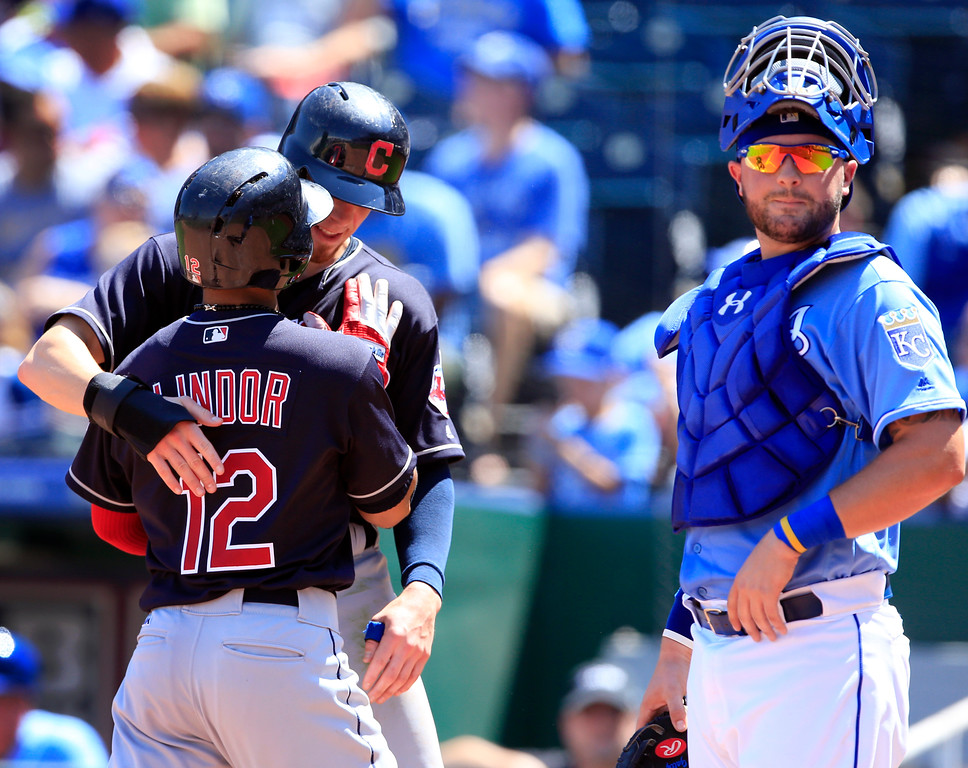 . Cleveland Indians\' Francisco Lindor (12) and Bradley Zimmer, back, celebrate in front of Kansas City Royals catcher Cam Gallagher, right, following Lindor\'s two-run home run in the second inning of a baseball game at Kauffman Stadium in Kansas City, Mo., Sunday, Aug. 20, 2017. (AP Photo/Orlin Wagner)