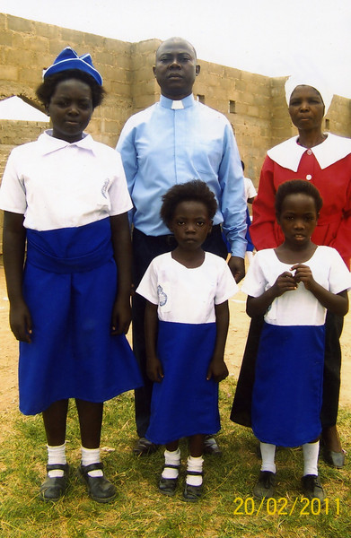 Rev Chilombo with his wife and daughters