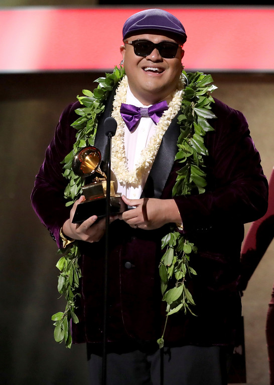 ". Kalani Pe\'a accepts the award for best regional roots music album for ""E Walea\"" at the 59th annual Grammy Awards on Sunday, Feb. 12, 2017, in Los Angeles. (Photo by Matt Sayles/Invision/AP)"