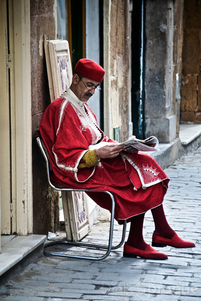 Reading the Morning Newspaper - Tunis, Tunisia