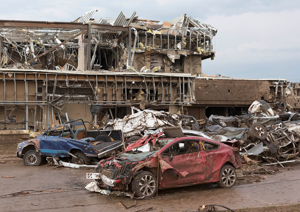 . The Moore Medical Center and vehicles lay damaged after a tornado moves through Moore, Okla. on Monday, May 20, 2013. (AP Photo/Alonzo Adams)