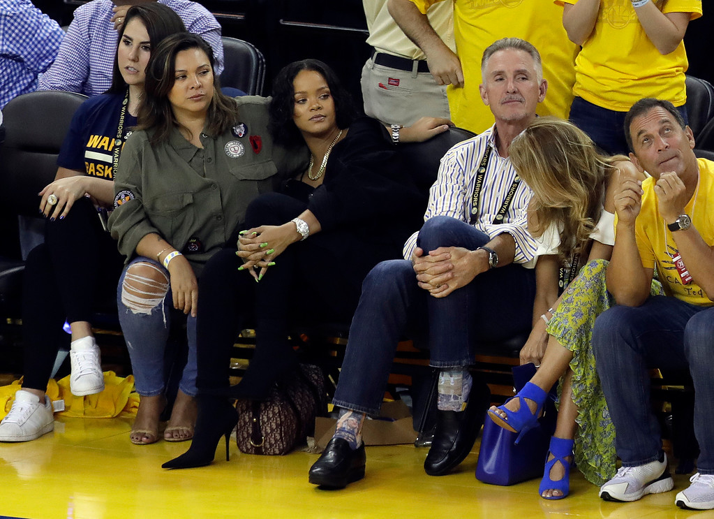 . Singer Rihanna, second from left, watches Game 1 of basketball\'s NBA Finals between the Golden State Warriors and the Cleveland Cavaliers Thursday, June 1, 2017, in Oakland, Calif. (AP Photo/Marcio Jose Sanchez)