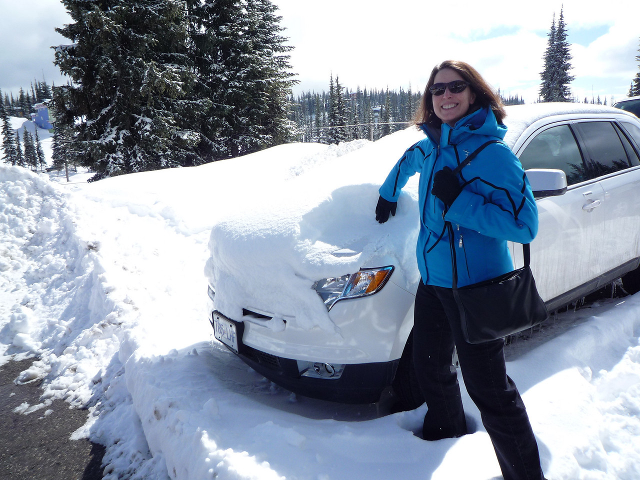 This is our rental car, a Ford Edge (they must be giving them away).  Very nice SUV actually with dual sun roofs, leather and Sirius radio.  Notice the snow on the hood.  We haven't moved it since we got here.