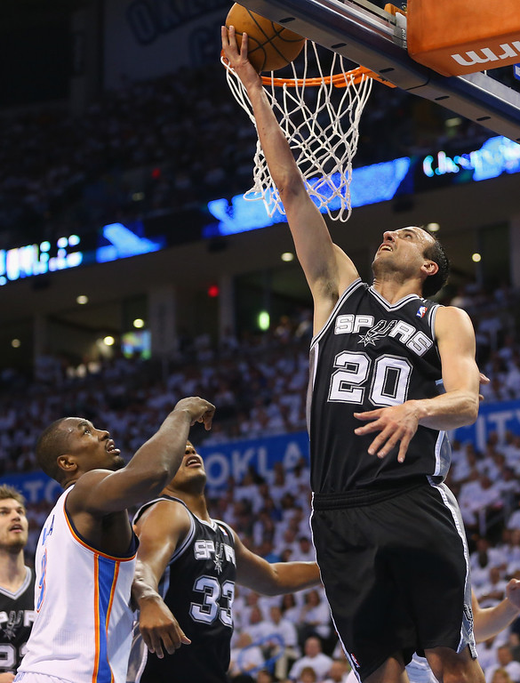 . OKLAHOMA CITY, OK - MAY 31:  Manu Ginobili #20 of the San Antonio Spurs takes a shot against the Oklahoma City Thunder in the first half during Game Six of the Western Conference Finals of the 2014 NBA Playoffs at Chesapeake Energy Arena on May 31, 2014 in Oklahoma City, Oklahoma. (Photo by Ronald Martinez/Getty Images)