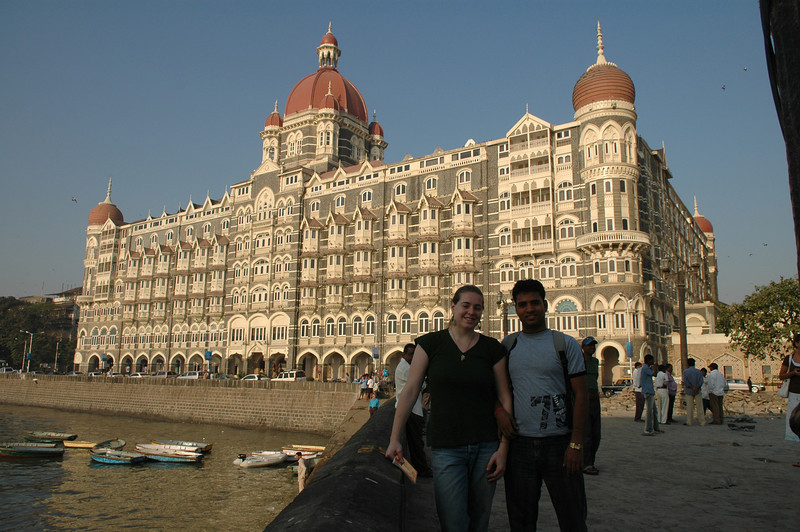 Cheryl and Dilip in front of the Taj Mahal Hotel in Mumbai