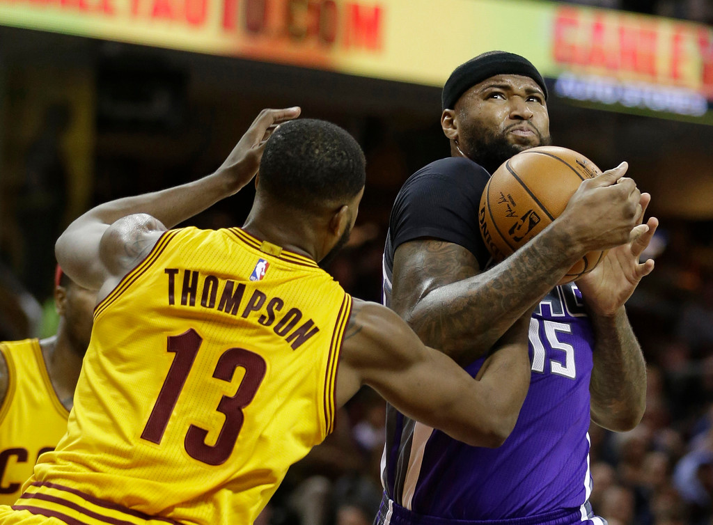 . Sacramento Kings\' DeMarcus Cousins (15) drives against Cleveland Cavaliers\' Tristan Thompson (13) in the first half of an NBA basketball game, Wednesday, Jan. 25, 2017, in Cleveland. (AP Photo/Tony Dejak)