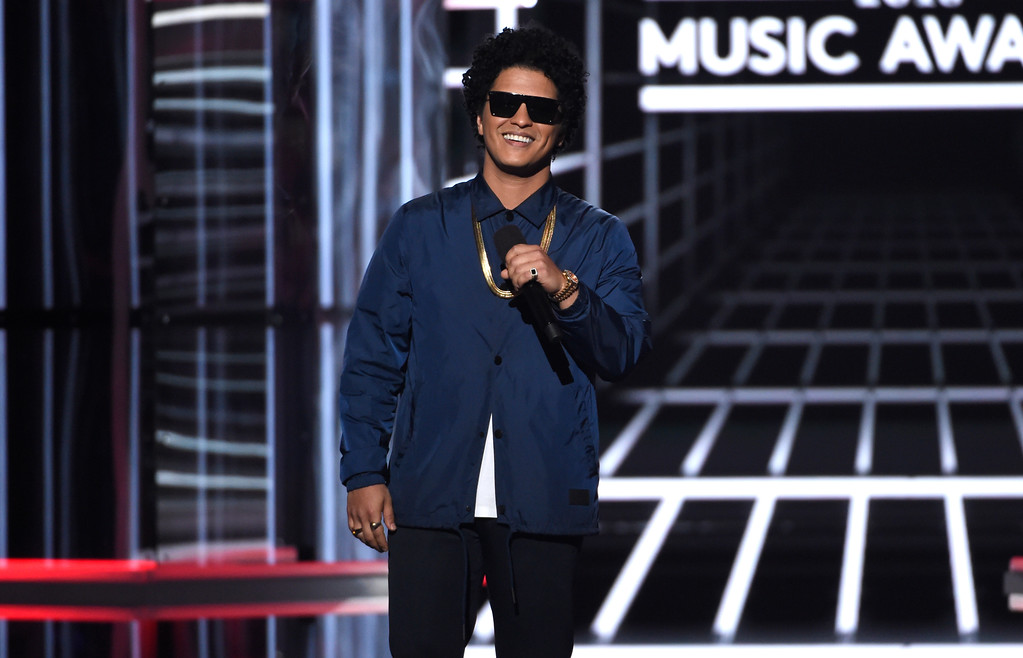 . Bruno Mars presents the Icon award at the Billboard Music Awards at the MGM Grand Garden Arena on Sunday, May 20, 2018, in Las Vegas. (Photo by Chris Pizzello/Invision/AP)