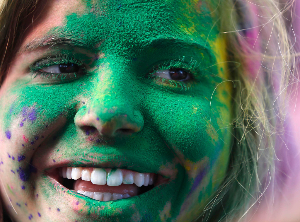 . A participant is covered in colored chalk during the Holi Festival of Colors at the Sri Sri Radha Krishna Temple in Spanish Fork, Utah, March 30, 2013.  REUTERS/Jim Urquhart