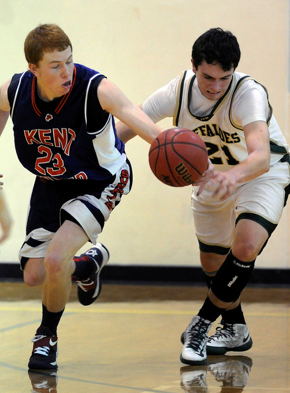 . Sun Devils senior Josh Repine (23) stole the ball from Buffaloes forward Devon Garcia (21) in the first half. The Bishop Machebeuf High School boy\'s basketball team hosted Kent Denver night, January 15, 2013. Karl Gehring/The Denver Post