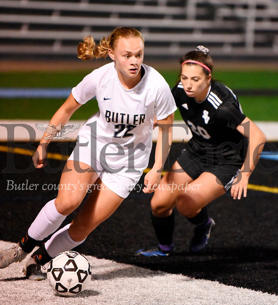 Harold Aughton/Butler Eagle: Butler's#22 brings the ball up the field in the second half against Seneca's #20.