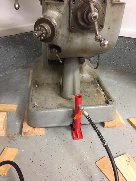 Use Hydraulic ram to lift machine