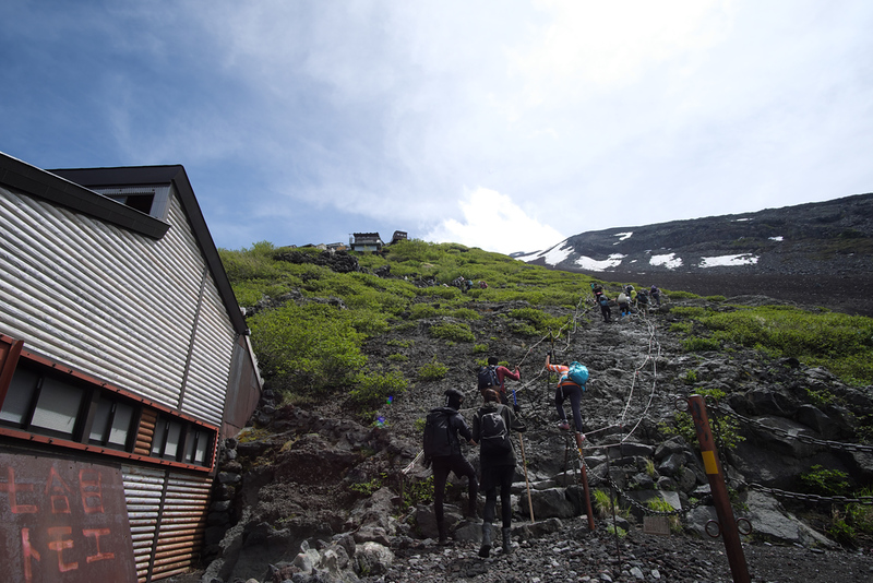 Climbers near mountain huts on Mt Fuji. Editorial credit: IsnakeDesign / Shutterstock.com