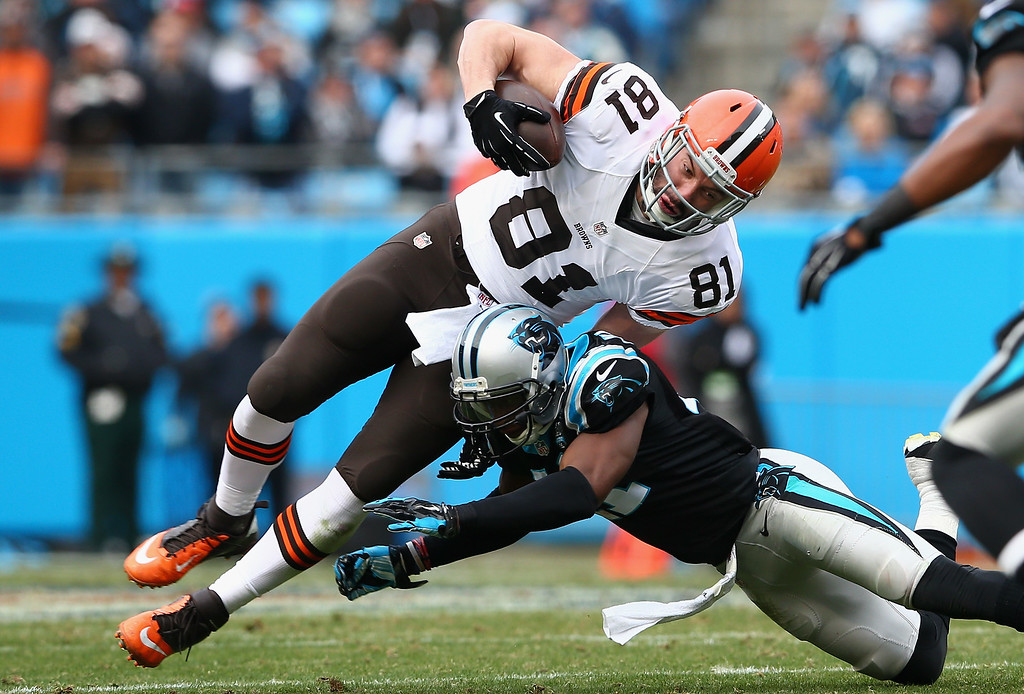 . CHARLOTTE, NC - DECEMBER 21:   Roman Harper #41 of the Carolina Panthers tackles  Jim Dray #81 of the Cleveland Browns in the 3rd quarter during their game at Bank of America Stadium on December 21, 2014 in Charlotte, North Carolina.  (Photo by Streeter Lecka/Getty Images)