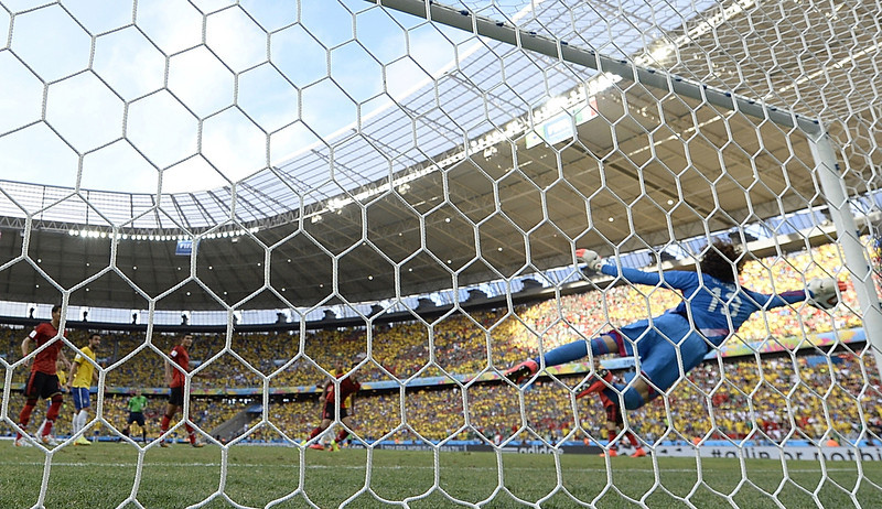 . Mexico\'s goalkeeper Guillermo Ochoa dives for the ball during a Group A football match between Brazil and Mexico in the Castelao Stadium in Fortaleza during the 2014 FIFA World Cup on June 17, 2014.  (YURI CORTEZ/AFP/Getty Images)