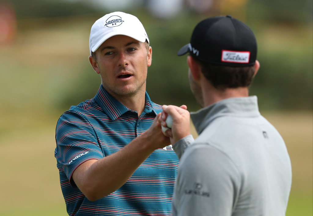 . Jordan Spieth of the US, left, touches fists with Patrick Cantlay of the US during a practice round ahead of the British Open Golf Championship in Carnoustie, Scotland, Wednesday July 18, 2018. (AP Photo/Jon Super)
