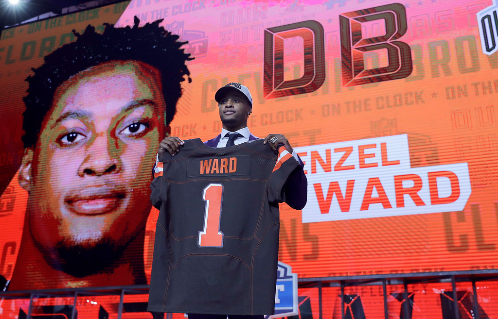 . Ohio State\'s Denzel Ward poses with his Cleveland Browns jersey during the first round of the NFL football draft, Thursday, April 26, 2018, in Arlington, Texas. (AP Photo/David J. Phillip)