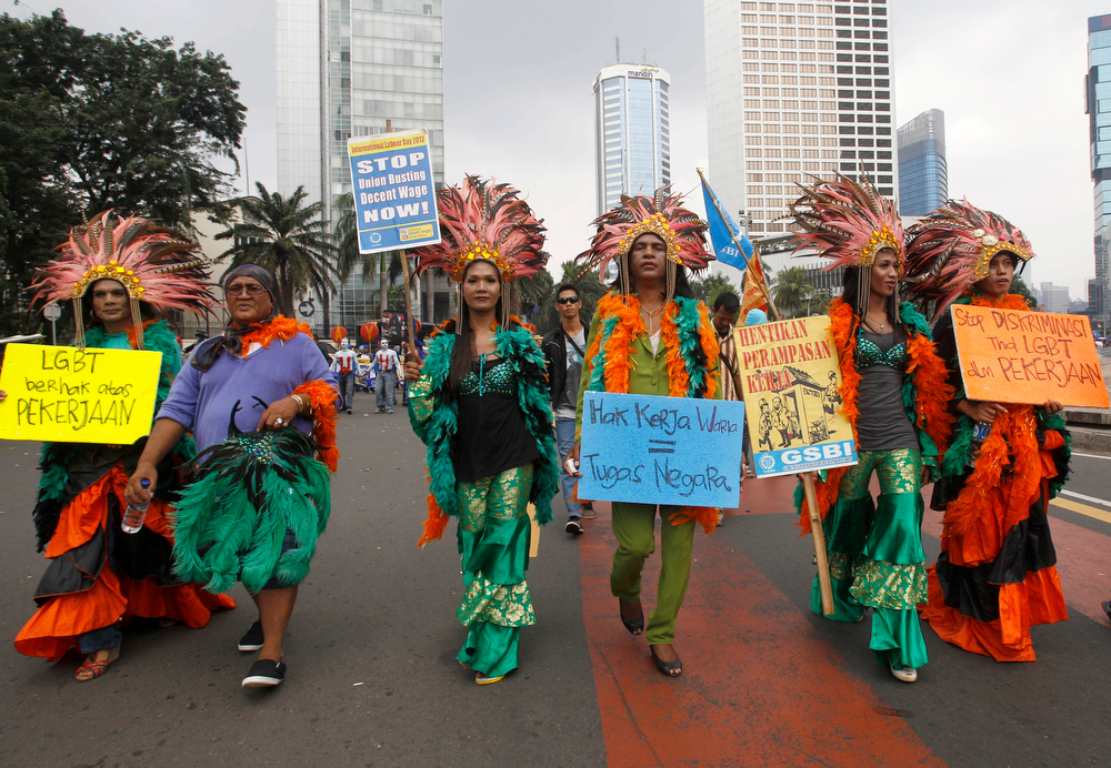 Description of . Indonesian transvestites take part in a May Day rally in Jakarta, Indonesia, Wednesday, May 1, 2013. (AP Photo/Achmad Ibrahim)