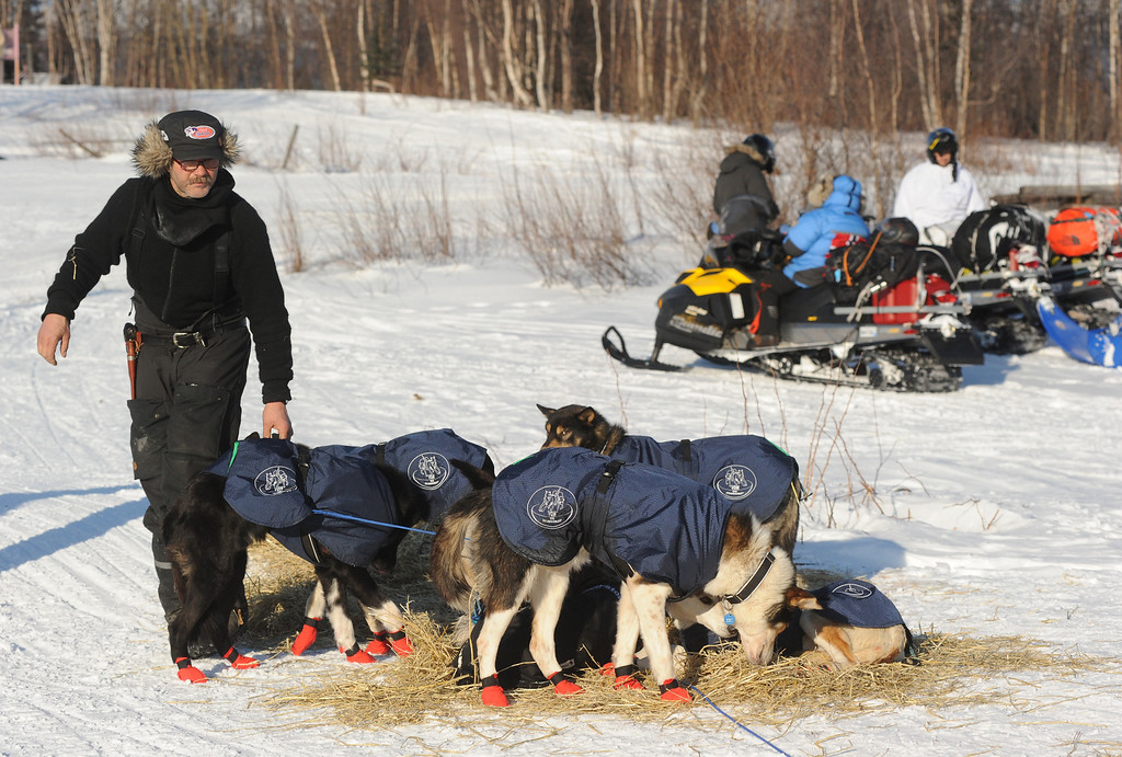 . Robert Sorlie prepares to leave the Yukon River village of Kaltag during the 2014 Iditarod Trail Sled Dog Race on Saturday, March 8, 2014. (AP Photo/The Anchorage Daily News, Bob Hallinen)