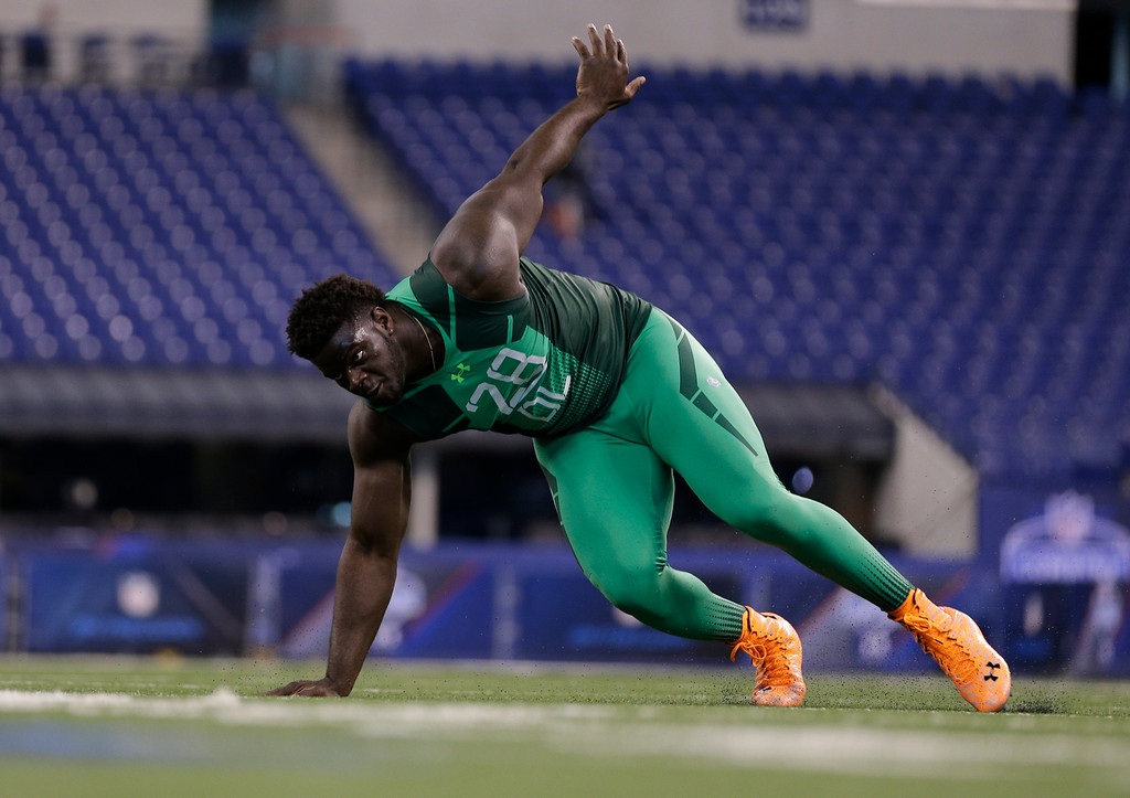 . Memphis defensive lineman Martin Ifedi runs a drill at the NFL football scouting combine in Indianapolis, Sunday, Feb. 22, 2015. (AP Photo/David J. Phillip)