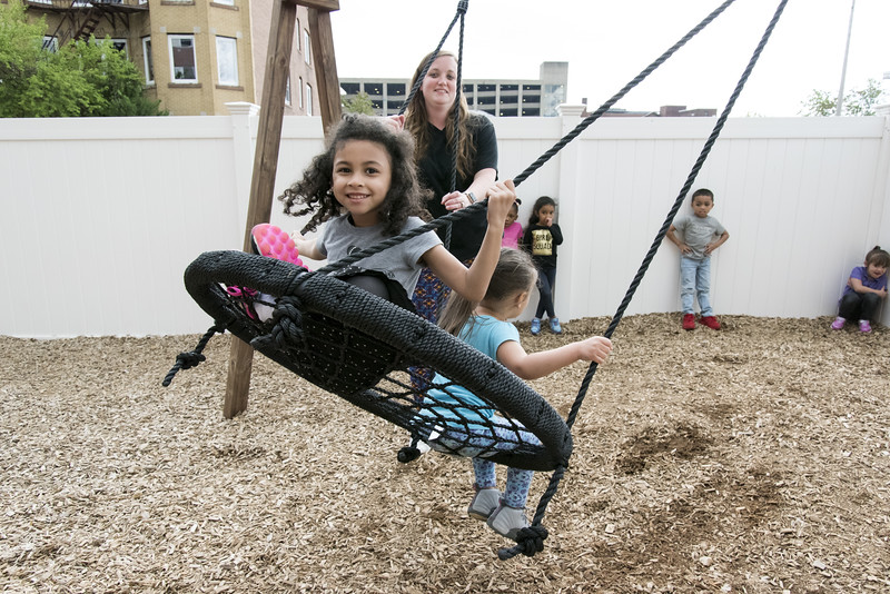 05/20/19  Wesley Bunnell | Staff  Juliet Barnes is all smiles as she rides on the outdoor swing at the YMCA on Monday afternoon during their school readiness program for children aged 3-5.