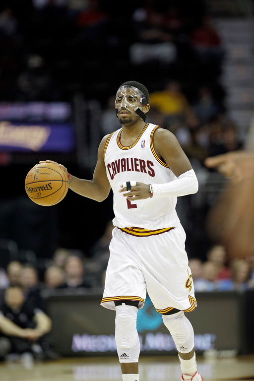 . Cleveland Cavaliers\' Kyrie Irving brin gs the ball up against the Toronto Raptors in an NBA basketball game Tuesday, Dec. 18, 2012, in Cleveland. (AP Photo/Mark Duncan)