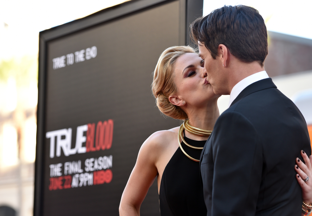 Description of . Anna Paquin, left, and Stephen Moyer kiss as they arrive at the Los Angeles premiere of the 7th and final season of