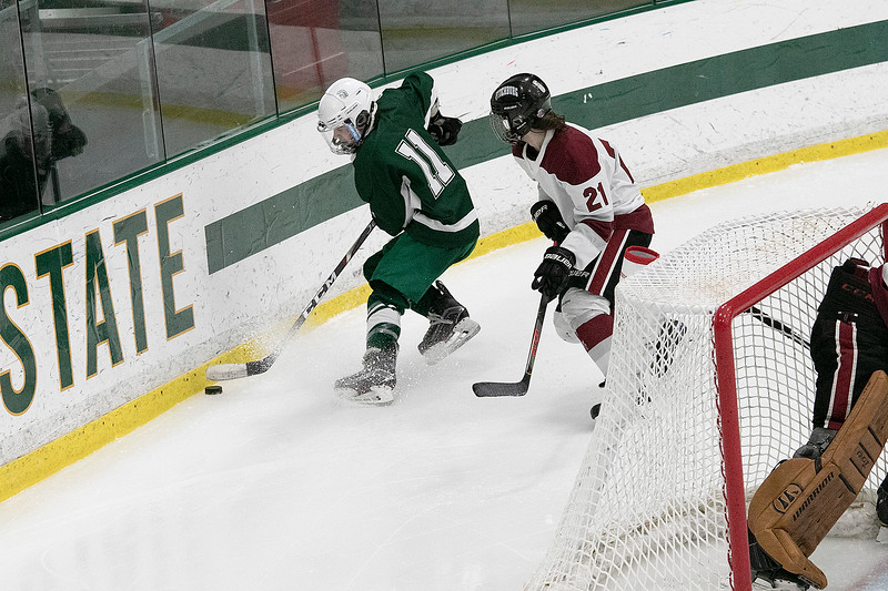 Fiutchburg High School/Monty Tech hockey played Oakmont Regional High school on Thursday afternoon, Feb. 13, 2020 at the Wallace Civic Center at Fitchburg State University in Fitchburg. ORHS's #11 Zack Sarasin and FHS's #21 Wyatt Peters. SENTINEL & ENTERPRISE/JOHN LOVE
