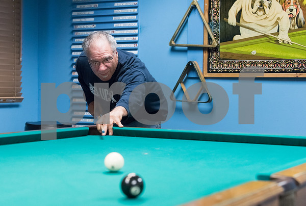 12/05/17 Wesley Bunnell | Staff Richard Berardy shoots during a game of 8 ball at the Bristol Senior Center on Tuesday afternoon.