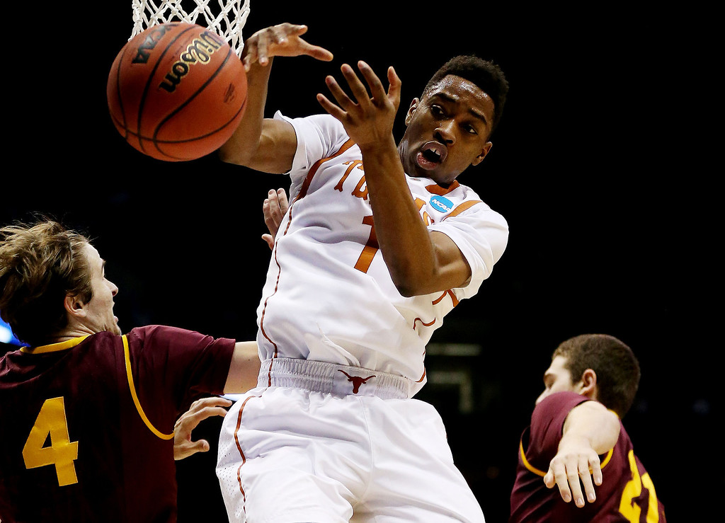 . Isaiah Taylor #1 of the Texas Longhorns and Bo Barnes #4 of the Arizona State Sun Devils vie for a rebound in hte first half during the second round of the 2014 NCAA Men\'s Basketball Tournament at BMO Harris Bradley Center on March 20, 2014 in Milwaukee, Wisconsin.  (Photo by Jonathan Daniel/Getty Images)