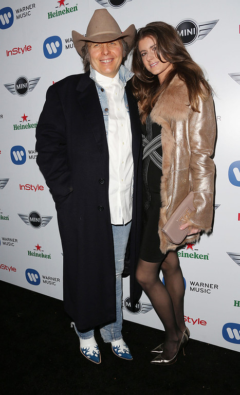 . Recording artist Dwight Yoakam (L) and his guest attend Warner Music Group\'s 2013 Grammy Celebration at Chateau Marmont\'s Bar Marmont on February 10, 2013 in Hollywood, California.  (Photo by Frederick M. Brown/Getty Images)