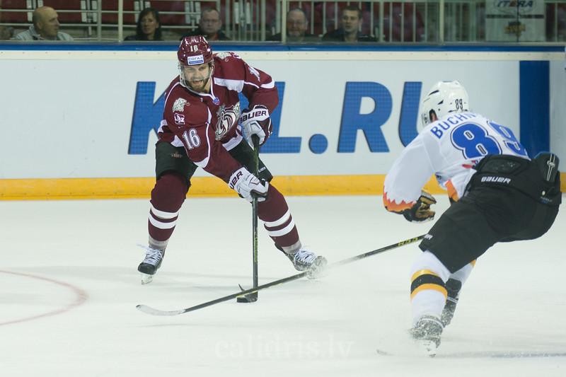 Steven Seigo (16) of Dinamo Riga with the puck