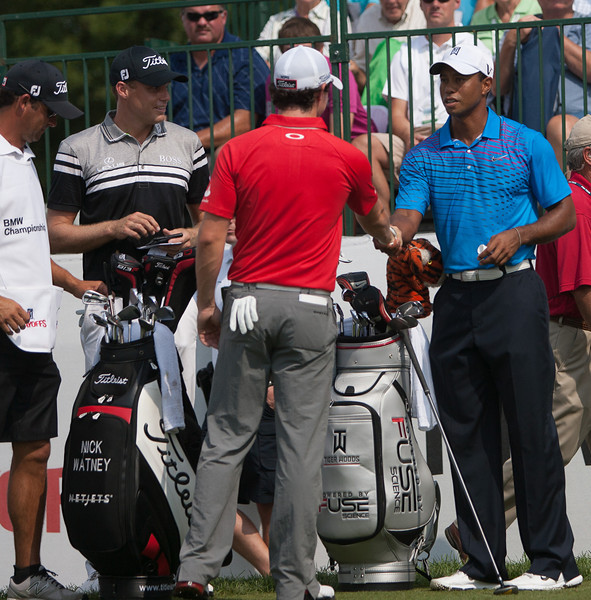 Rory Mcllroy and Tiger Woods shake hands before first round action at the BMW Championship at Crooked Stick CC in Carmel Indiana on Thursday Sept. 6, 2012. (Charles Cherney/WGA)